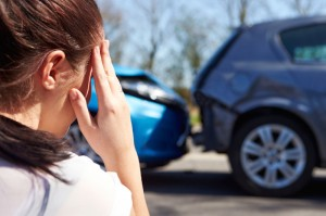 Car accident with women holding head